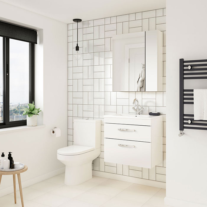 Minimalist bathroom with white subway tiles and wall hung furniture